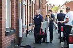 © Joel Goodman - 07973 332324 . 08/07/2017 . Bolton , UK . Firefighters offer householders free smoke detectors in houses adjacent to the scene on Rosamond Street in Daubhill , where a fatal house fire burned through a mid-terrace house this morning (Saturday 8th July 2017) . Firefighters responded at 9am this morning (Saturday 8th July 2017) . A family of five are reported to have been inside at the time and there are understand to me multiple fatalities . Photo credit : Joel Goodman