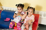 Education Preschool child care toddlers age 2 two girls parallel pretend play talking on or dialing cell telephones