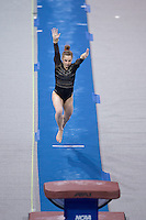 LOS ANGELES, CA - April 19, 2013:  Stanford's Kristina Vaculik competes on vault during the NCAA Championships at UCLA.