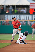 Boston Red Sox second baseman Dustin Pedroia (15), on rehab assignment with the Pawtucket Red Sox, follows through on a throw to first base as Jermaine Curtis (11) slides into second base during a game against the Rochester Red Wings on May 19, 2018 at Frontier Field in Rochester, New York.  Rochester defeated Pawtucket 2-1.  (Mike Janes/Four Seam Images)