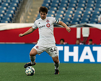 FOXBOROUGH, MA - JULY 23: Kevin Politz #64 of Toronto FC II passes the ball during a game between Toronto FC II and New England Revolution II at Gillette Stadium on July 23, 2021 in Foxborough, Massachusetts.