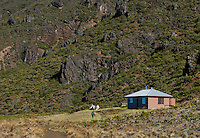Male hikers relaxing at the Kapalaoa cabin inside the crater in HALEAKALA NATIONAL PARK on Maui in Hawaii USA