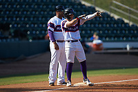 Steele Walker (6) of the Winston-Salem Rayados points to a teammate as he stands on third base during the game against the Lynchburg Hillcats at BB&T Ballpark on June 23, 2019 in Winston-Salem, North Carolina. The Hillcats defeated the Rayados 12-9 in 11 innings. (Brian Westerholt/Four Seam Images)