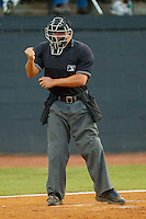 Home plate umpire Jeremy Riggs makes a strike call during an Appalachian League game between the Greeneville Astros and the Bristol White Sox at Boyce Cox Field July 1, 2010, in Bristol, Tennessee.  Photo by Brian Westerholt / Four Seam Images
