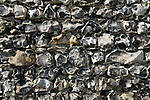 Close up detail of a knapped flint stone wall. Arundel, West Sussex. England 2006.