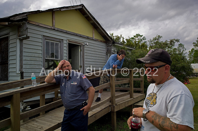 Jacksonville, Florida<br /> November 4, 2013<br /> <br /> Veteran's sustainable farm founded by Purple Heart veteran Adam Burke and managed by Afghan and Iraqi veteran Steve Ellseberry.<br /> <br /> Volunteer Gaines Matheny (on the phone), Marine Trey Evans (leaning on banister) and Steve Ellseberry share a story. The farm provides excellent comradery between the vets and allows them to share combat stories with those who have been there.