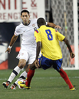 Clint Dempsey #8 of the USA MNT dribbles the ball towards Victor Ibarbo #8 of Colombia during an international friendly match at PPL Park, on October 12 2010 in Chester, PA. The game ended in a 0-0 tie.