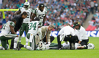 04.10.2015. Wembley Stadium, London, England. NFL International Series. Miami Dolphins versus New York Jets. New York Jets Strong Safety Calvin Pryor receives medical attention on th pitch for a injured left leg.