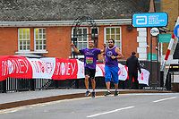 3rd October 2021; London, England: The Virgin Money 2021 London Marathon: Virtual London Marathon runner going along the crossing at Narrow Street Swing Bridge, Limehouse Basin between mile 14 and 15 before the arrival of the wheelchair competitors.