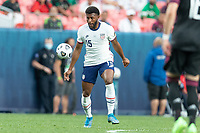 DENVER, CO - JUNE 6: Mark McKenzie #15 of the United States moves with the ball during a game between Mexico and USMNT at Mile High on June 6, 2021 in Denver, Colorado.