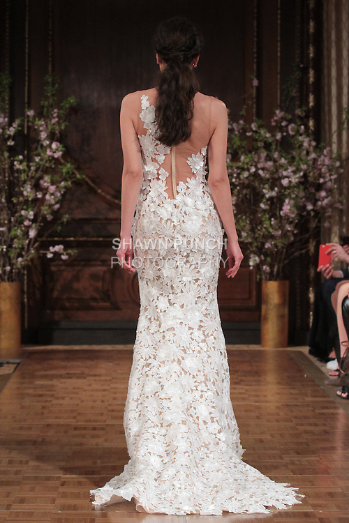 """Model walks runway in a """"Skyler"""" bridal gown from the Isabelle Armstrong Spring Collection 2017, at Lotte New York Palace Hotel, during New York Bridal Fashion Week Spring Summer 2017 on April 16, 2017."""