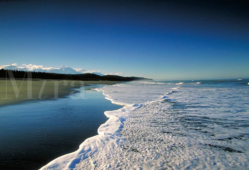 Mt. Fairweather and Fairweather Mountain (Range)  Glacier Bay National Park  Alaska  Pacific Ocean rolls up on beaches. Alaska, Glacier Bay National Park.