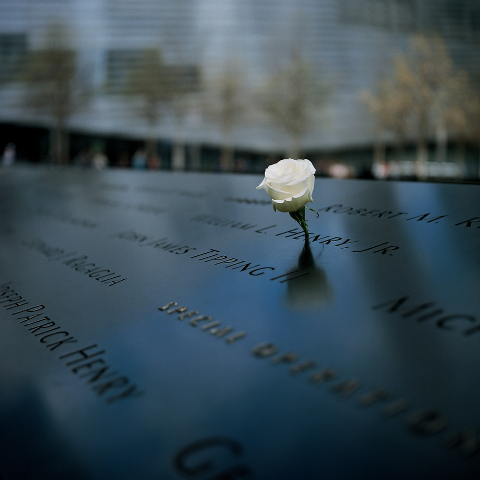 A white rose stands in memory of a deceased firefighter, William L. Henry Jr. of FDNY Rescue 1, along the waterfall marking the former location of the World Trade Center South tower at the 9/11 Memorial Plaza in Manhattan, New York on Sunday, April 29, 2018. (Photo by James Brosher)