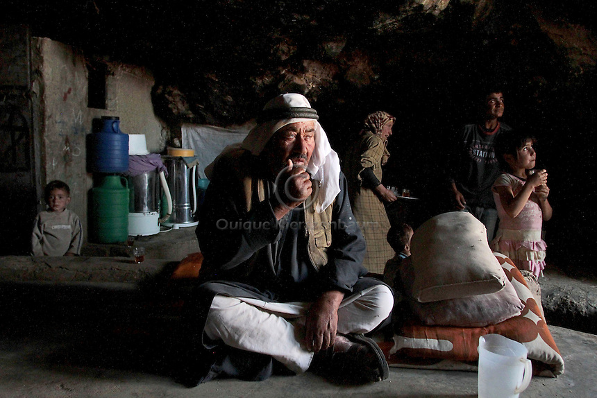 """Hamid Jabareen and his family are seen in his cave in Jenba a Palestinian town of 50 families seats in an area called by the IDF as """"Firing Zone 918"""" and is located in the southern Hebron hills near the town of Yatta.  Spread over 30,000 dunams, it includes twelve Palestinian villages.  According to OCHA figures, 1,622 people lived in the area in 2010, and according to local residents the number of inhabitants currently stands at about 1,800. For over a decade, the residents of twelve uniquely traditional Palestinian villages in the area of Masafer-Yatta in the south Hebron hills have lived under the constant threat of demolition, evacuation, and dispossession.<br /> <br /> The State's insistence on evacuation of Firing Zone 918 in part or in whole, if acceptance by the HCJ, might result in an immediate humanitarian disaster for almost two thousand souls, the destruction of villages, and the eradication of a remarkable way of life that has endured for centuries."""
