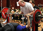 Charlie Rice, 84, competes Tuesday, Nov. 1, 2011, in the men's masters 75+ division of the bench press competition at the World Bench Press and Dead Lift Championships in Reno, Nev. Rice's trainer Scott Dolan is at top..Photo by Cathleen Allison