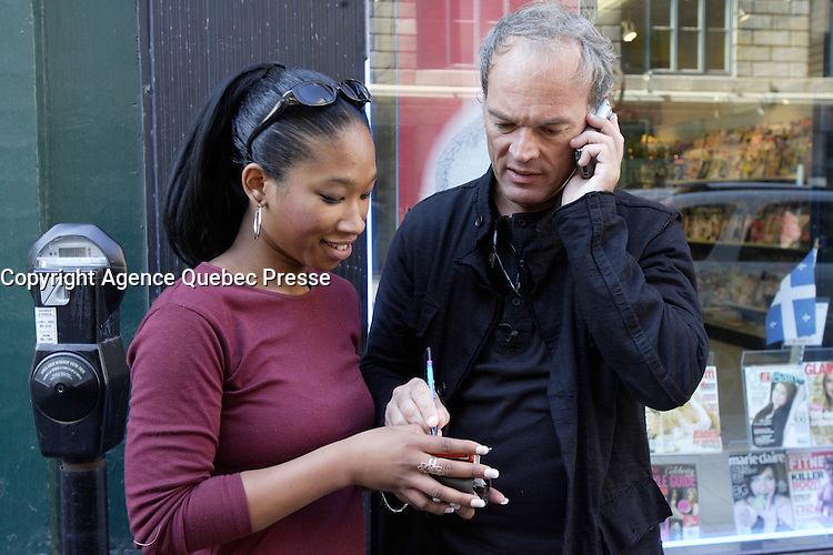 French TV personnality Laurent Baffie (L) sign an autograph in Old-Montreal