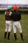 Grand National horse Race Aintree. Two amateur jockeys watch the race they have been thrown from their horses. Liverpool Lancashire 1980s