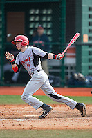 Nick Campana (14) of the Hartford Hawks follows through on his swing against the Virginia Cavaliers at The Ripken Experience on February 27, 2015 in Myrtle Beach, South Carolina.  The Cavaliers defeated the Hawks 5-1.  (Brian Westerholt/Four Seam Images)
