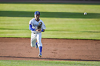 Deion Ulmer (3) of the Ogden Raptors throws to first base while on defense against the Orem Owlz in Pioneer League action at Lindquist Field on June 18, 2015 in Ogden, Utah.  This was Opening Night play of the 2015 Pioneer League season.  (Stephen Smith/Four Seam Images)