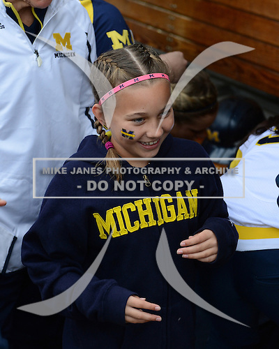 Michigan Wolverines bat girl in the dugout before the season opener against the Florida Gators on February 8, 2014 at the USF Softball Stadium in Tampa, Florida.  Florida defeated Michigan 9-4 in extra innings.  (Copyright Mike Janes Photography)