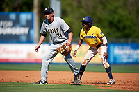 Michigan Wolverines right fielder Christan Bullock (5) leads off first base behind first baseman John McKenna (21) during a game against Army West Point on February 17, 2018 at Tradition Field in St. Lucie, Florida.  Army defeated Michigan 4-3.  (Mike Janes/Four Seam Images)