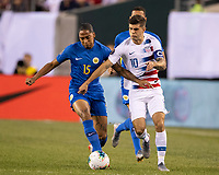 PHILADELPHIA, PA - JUNE 30: Christian Pulisic #10 battles Shermaine Martina #15 during a game between Curacao and USMNT at Lincoln Financial Field on June 30, 2019 in Philadelphia, Pennsylvania.