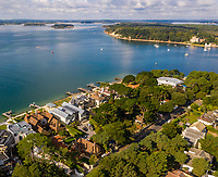 BNPS.co.uk (01202) 558833. <br /> Pic: TailorMade/BNPS<br /> <br /> Pictured: World class location, Harbour Gate has stunning views of Poole Harbour. <br /> <br /> A multi-millionaire is hoping to have a shot at selling his luxury mansion - by throwing a hi-tech golf simulator into the deal.<br />  <br /> Golf-loving Barry Bester put the waterfront property on Sandbanks, Dorset, on the market for £11m last year.<br />  <br /> He is now offering his £40,000 state-of-the-art simulator he has had built on the grounds with the sale.
