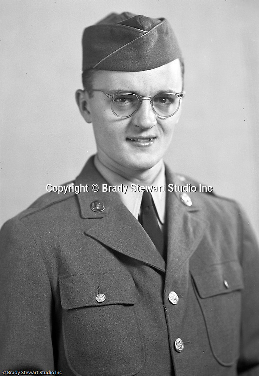 Wilkinsburg PA:  Brady Stewart Jr. in his uniform before heading off to New York to join his unit - 1941.  He was stationed at two bases in New York with the last being Camp Shanks, located in Orangeburg, Rockland County, New York was the final stateside stop for 1.3 million soldiers who were processed through this staging area and prepared for departure.  Brady Stewart Jr photographed all departing soldiers.