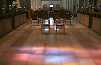 "Light coming through the stained glass window, ""Service"" by Mark Angus lands on the floor.  Looking away from the High Altar of Guildford Cathedral."