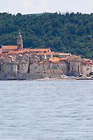 View across the sea on the town of Korcula on the island of the same name where Marco Polo was born Korcula Island. Dalmatian Coast, Croatia, Europe.