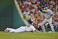 20 September 2012: Washington Nationals outfielder Jayson Werth dives back to first as Adrian Gonzalez catches a pickoff attempt during game action against the Los Angeles Dodgers at Nationals Park in Washington, DC. The Nationals defeated the Dodgers 4-1, clinching a playoff birth: the first time for a Washington franchise since 1933. Mandatory Credit: Ed Wolfstein Photo
