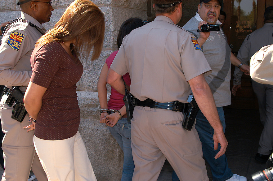 """Protesting the SB1611 at the State Capitol in Phoenix, AZ A mother (Alma Sotelo cq) and her 15 year old Daughter are arrested for chanting """"No Mas"""" during the hearing while State Senator Kyrsten Sinema (cq) was speaking on Tuesday, February 22, 2011."""
