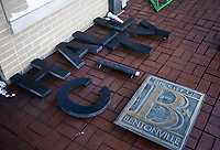 Removed signs are displayed, Friday, February 19, 2021 at the old Bentonville City Hall in Bentonville. The signs will be repurposed to other city buildings. Check out nwaonline.com/210220Daily/ for today's photo gallery. <br /> (NWA Democrat-Gazette/Charlie Kaijo)