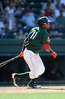 Second baseman Wendell Rijo (11) of the Greenville Drive bats in a game against the Savannah Sand Gnats on Sunday, June 22, 2014, at Fluor Field at the West End in Greenville, South Carolina. Rijo is the No. 18 prospect of the Boston Red Sox, according to Baseball America. Greenville won, 7-3. (Tom Priddy/Four Seam Images)