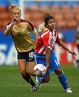 Evelyn Armoa (PAR) and Kristie Mewis (USA)..FIFA U17 Women's World Cup, Paraguay v USA, Waikato Stadium, Hamilton, New Zealand, Sunday 2 November 2008. Photo: Renee McKay/PHOTOSPORT