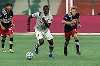 FOXBOROUGH, MA - SEPTEMBER 23: Victor Wanyama #2 of Montreal Impact dribbles as Scott Caldwell #6 of New England Revolution defends during a game between Montreal Impact and New England Revolution at Gillette Stadium on September 23, 2020 in Foxborough, Massachusetts.