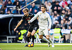 Cristiano Ronaldo (r) of Real Madrid battles for the ball with Sergi Samper Montana of Granada CF during their La Liga match between Real Madrid and Granada CF at the Santiago Bernabeu Stadium on 07 January 2017 in Madrid, Spain. Photo by Diego Gonzalez Souto / Power Sport Images