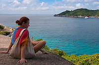 Girl sitting on the rock of Similan island #8
