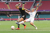 Ellen WHITE of Great Britain challenges Rebecca SMITH of New Zealand - Great Britain Women vs New Zealand Women - Womens Olympic Football Tournament London 2012 Group E at the Millenium Stadium, Cardiff, Wales - 25/07/12 - MANDATORY CREDIT: Gavin Ellis/SHEKICKS/TGSPHOTO - Self billing applies where appropriate - 0845 094 6026 - contact@tgsphoto.co.uk - NO UNPAID USE.