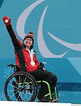 Marie Wright, PyeongChang 2018 - Wheelchair Curling // Curling en fauteuil roulant.<br /> Marie Wright receives the bronze medal // Mark Ideson reçoit la médaille de bronze. 17/03/2018.