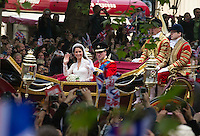 Princess Kate and Prince William wave to the crowd as they come down the mall in London. .Picture: Maurice McDonald/Universal News And Sport (Europe).29 April 2011..