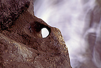 This mooring hole carved into the rock at South Point on the Big Island of Hawaii is an historic artifact of early Polynesian culture.