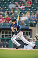 Northwest Arkansas Naturals infielder Taylor Featherston (12) connects on a pitch during a Texas League game between the Northwest Arkansas Naturals and the Arkansas Travelers on May 30, 2019 at Arvest Ballpark in Springdale, Arkansas. (Jason Ivester/Four Seam Images)