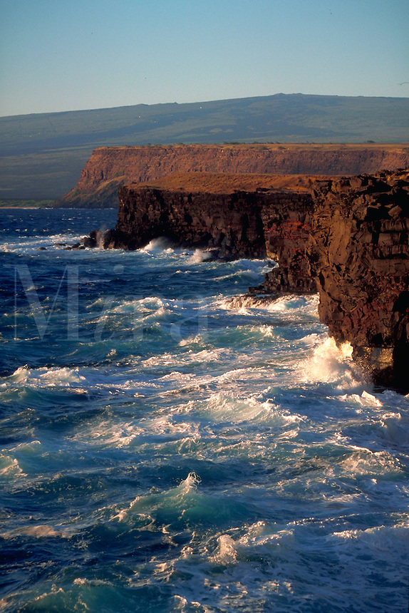 Waves crashing against cliffs at Ka Lai, Hawaii, the southernmost point of the USA.