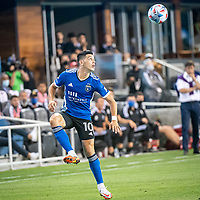 SAN JOSE, CA - AUGUST 13: Cristian Espinoza #10 of the San Jose Earthquakes traps the ball during a game between San Jose Earthquakes and Vancouver Whitecaps at PayPal Park on August 13, 2021 in San Jose, California.