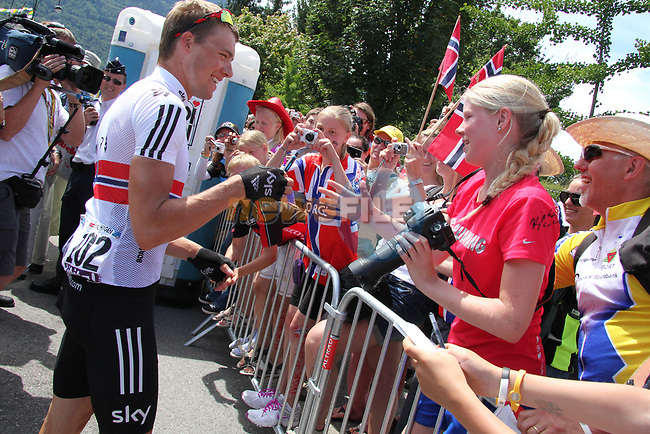 Edvald Boasson Hagen (NOR) Sky Procycling signs autographs for Norwegian fans at sign on before Stage 11 of the 99th edition of the Tour de France 2012, running 148km from Albertville to La Toussuire Les Sybelles, France. 12th July 2012.<br /> (Photo by Thomas van Bracht/NEWSFILE)