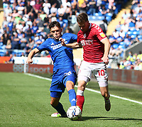 28th August 2021; Cardiff City Stadium, Cardiff, Wales;  EFL Championship football, Cardiff versus Bristol City; Ryan Giles of Cardiff City tackles Andy King of Bristol City from behind