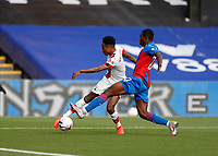 12th September 2020; Selhurst Park, London, England; English Premier League Football, Crystal Palace versus Southampton; Kyle Walker-Peters of Southampton crossing the ball past Tyrick Mitchell of Crystal Palace