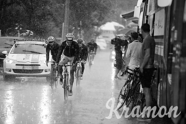 riders arriving at the team buses in a rain storm after finishing the stage<br /> <br /> stage 17: Digne-les-Bains - Pra Loup (161km)<br /> 2015 Tour de France