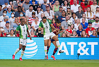 AUSTIN, TX - JUNE 16: Onome Ebi #5 of Nigeria battles for the ball with Christen Press #23 of the USWNT during a game between Nigeria and USWNT at Q2 Stadium on June 16, 2021 in Austin, Texas.